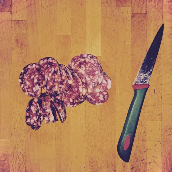 Salami Slices and Knife by Jens Haas